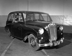 Austin Mayflower car with AWA radio at Petersham garage. Max Dupain photo, c 1951.