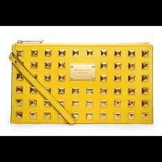 Michael Kors Yellow Clutch w/ Gold Studs Michael Kors Yellow Clutch w/ Gold Studs!  Saffiano Leather! Great for a day or night!! Super fun and fierce to wear around your wrist!! Michael Kors Bags Clutches & Wristlets