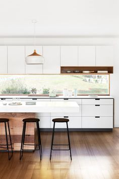 modern white kitchen with rustic wood island base