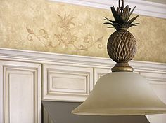 The kitchen is a perfect place to add warmth with faux glazed walls. A classical, yet whimsical pineapple motif over the stove hood continues the kitchen theme. Mexican Kitchen Decor, Kitchen Decor Themes, Vintage Kitchen Decor, Cool Diy, Pineapple Lights, Genius Ideas, Rose Gold Kitchen, Mason Jars, Glazed Walls