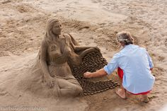Doing a sand sculpture on a beach in Marbella