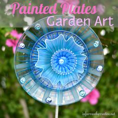DIY Home Decor | Add a pop of color outside with this easy flower garden art made from Dollar Tree plates.