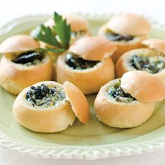This unique appetizer features traditional escargot with garlic butter sauce, wrapped in tender brioche and stylishly decorated.  The rich brioche is a perfect foil for the garlicky, mushroom-like flavors of the escargot.  Each bite-size morsel is complete - no need for a dip!  A gourmet treat.