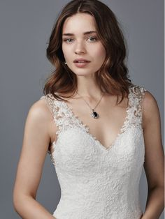 Sottero and Midgley - PALMER, This chic fit-and-flare features a striking illusion open back accented in beaded lace motifs and Swarovski crystals. Delicate lace appliqués cascade over this Ferryn Satin wedding dress, accenting the V-neckline, illusion straps, and double-scalloped hem. Finished with covered buttons and zipper closure.