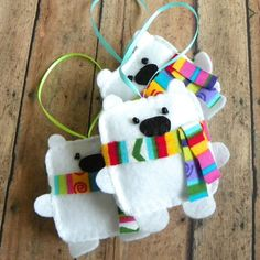 Mr. Polar Bear is ready for winter with his little scarf, he is the perfect addition to your ornament collection. He is 3 dimensional and has just as much personality as he does cuteness! He measures approximately 3 1/4 x 3 1/4 and is about 3/4 thick. He has been designed and completely hand made from start to finish by me. His eyes are glass beads and his scarf is flannel. He is gently weighted and stuffed to hang perfectly from his 3 ribbon. The pattern for these adorable be...