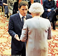 """Rob Brydon receiving his MBE from the Queen.""""I look like a buffoon in that picture. Have you heard of a resting bitch face? That's my resting doofus face,' he said"""