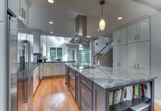 White cabinets, those floors, those countertops, that style cabinet.