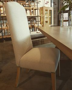 Chair by Pierre Cronje upholstered in Bamboo Rib colour Bone/Linen