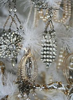 Old rhinestone earrings.......clever ornaments for a small silver themed Christmas tree.