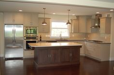 This new kitchen was a feature in a custom home renovation we completed, with the help of Creation Cabinets. Beautiful lighting and island make for a great space to prepare meals or entertain!