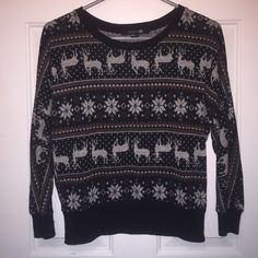 Forever 21 winter/holidaysweater Forever 21 winter/holiday sweater. Size small. Has reindeer with burgundy stripes and Silver snowflakes. Only wore one time.in excellent condition. No holes no stains. Forever 21 Sweaters Crew & Scoop Necks