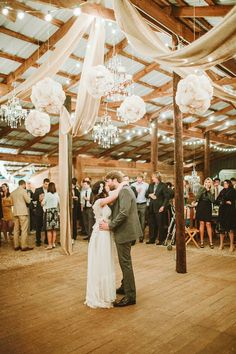tissue poms + chandeliers in the barn | Ben and Colleen #wedding