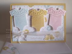 Something for Baby is the stamp set used on this card. I used the Delicate Designs embossing folder for the feature around the neck line.