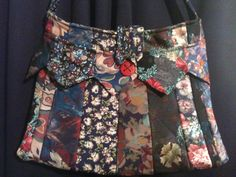 Go to Glamarita and visit with Ronnie.  I bot one of these last Spring and I adore it.  Necktie tote bag...custom orders available!