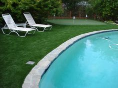 Artificial grass around pool. Attractive & safer than concrete. Looks sharp!