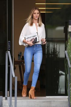 Beauty: Rosie Huntington-Whiteley was effortlessly stunning as she breezed into an appointment in West Hollywood, California, on Thursday