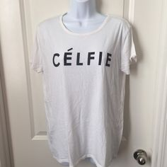 Celfies Tee MAKE ME AN OFFER, BUNDLE AND SAVE! Please read full description before purchasing:   Condition: Pre-loved Brand: Fifth Sun  Color: white and black  Size: XL Flaws: None   *Please message me for measurements and with questions!   -> NO SWAPS or HOLDS -> YES TO BUNDLES  -> ALL SALES ARE FINAL!!  -> ITEMS COME FROM A PET/SMOKE FREE HOME <3 Faith Sun Tops Tees - Short Sleeve