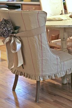 Love the slipcover and the embellishment.  It would be easy to change seasonally.