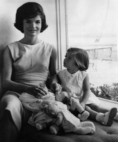 February 17, 1961: Jacqueline Kennedy and daughter Caroline relax together at home.