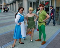 Belle from beauty & the beast and Tinkerbell and Peter Pan from Peter Pan, Disney Cosplay at Disney Expo 2013 Peter Pan Cosplay, Peter Pans, Costume Ideas, Costumes, Peter Pan Disney, Disney Cosplay, Maleficent, Disney And Dreamworks, Disney Cartoons