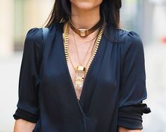 Love the layering of chunky necklaces, a look usually saved for the more delicate of necklaces