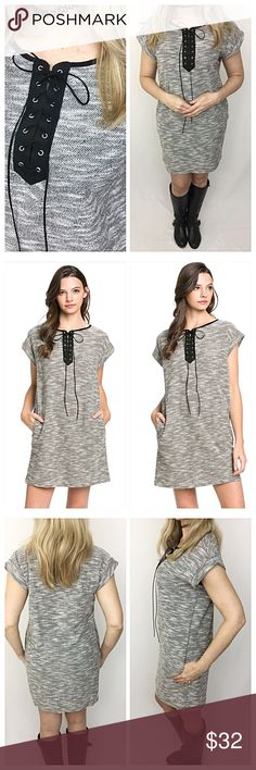 """Lovely Lace Up Marled Pocket Tunic Dress SMLXL Be cozy & cute in this lovely lace up front marled pocket tunic. Wear alone with boots or sandals or pair with leggings or jeans...love the versatility of this piece.  Very relaxed, stretchy fit especially in bust & waist. Black & ivory with silver grommets. 55% polyester - 45% cotton   Small (Will Fit Medium)  Bust 32-38"""" Length 33""""  Medium (Will Fit Large) Bust 40-42"""" Length 33.5""""  Large (Will Fit XL) Bust 42-44"""" Length 34"""" Dresses"""