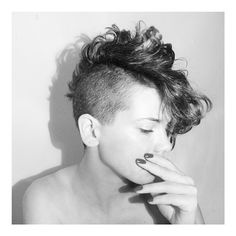 short curly haircut, undercut, mohawk