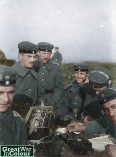 A group of young German  radio operators working in a field