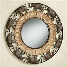 One by one, the animals in the Elephant Parade march with grace and dignity. Made of metal, this openwork elephant wall mirror has a rattan inner border. Elephant Bathroom Decor, Elephant Room, Elephant Home Decor, Elephant Parade, Elephant Trunk, Elephant Stuff, Elephant Decorations, Safari Decorations, Elephant Gifts