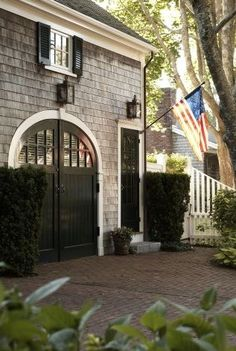 Garage for French house Sweet Southern Charm ⚓. Paint garage doors & exterior patio french doors black with white trim! House Design, Future House, House, House Exterior, Garage Doors, Shingle House, Exterior Design, Exterior, Curb Appeal