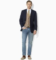 Navy blazer with vest and jeans.