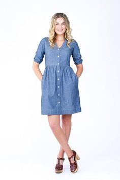 Easily adaptable modern shirt dress. Pattern features deep v-neck, button front, high waistline, multiple sleeve lengths, large pockets and ties at the back to