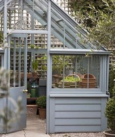 Classic painted wooden greenhouse