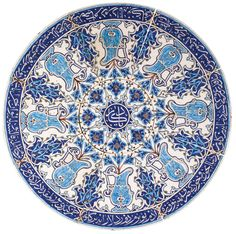 A KUTAHYA POTTERY COFFEE TABLE TOP, TURKEY, 19TH CENTURY comprising a central circular tile with eight fitted tiles surrounding it, set on a custom plexiglass table Quantity: 9 whole composition: 63.2cm. diam. Estimate 12,000 — 15,000 GBP LOT SOLD. 15,000 GBP (Hammer Price with Buyer's Premium)