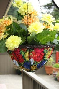 Toland Home Garden 202036 Dizzy Dahlias Hanging Art Planter, 14-Inch by Toland Home Garden. $29.13. 14-inch, fabric hanging planter is the perfect size for any home or patio; Planter's collapsible design allows for easy storage during the winter; Built in spout at the bottom allows excess water to drain; Holds up to 25-pounds or 2-gallons of soil; Durable inner liner helps to insulate the plants' roots enabling them to grow healthier. Stylish fabric Hanging Art Pl...