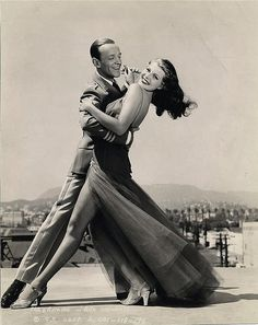 Fred Astaire and Rita Hayworth, Los Angeles with Hollywood sign and Hollywood Hills in background,1941.