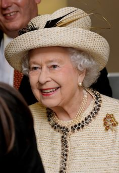 The Queen attending a Commonwealth Day function in March 2014, wearing her gold & ruby brooch that was a wedding present in 1947.