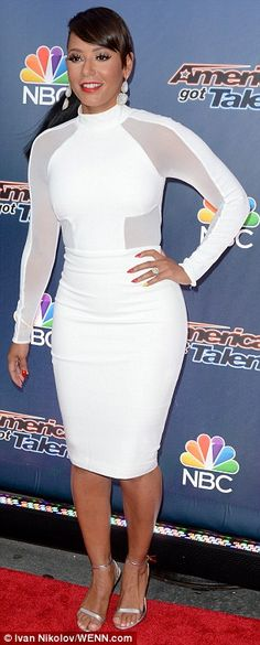 White hot: The 40-year-old singer looked utterly incredible as she showcased her gym-honed...