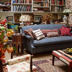 Bookcase filled with fabric, flowers framing the picture and an awesome striped ottoman creeping in. Under Stairs Cupboard, Living Spaces, Living Room, Home Libraries, Shabby, Cozy Living, Architectural Digest, Eclectic Decor, Cozy House