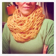 Arm knitting infinity scarf.