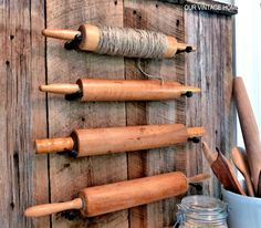 Using what she had on hand, which was barn wood, for the back, attached them to the wall with a nail gun and then, with a table saw, ripped a few strips off another plank to use for the top and bottom trim.  For the pegs, she used oil rubbed bronze door stops from Lowe's.