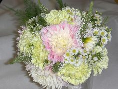 1920's themed wedding Bridal bouquet with Dahlia's, carnations, veronica and monte casino. This was wrapped with lace ribbon.