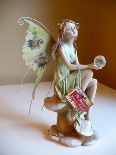 8 in. Fairy Holding Crystal Ball- Metal Wings – johnnyappleseedhomeandyard