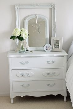 Another example of a small chest used as a night stand.  Great idea for a small bedroom.