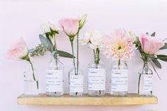 DIY vintage pharmacy/apothecary glass bottles with flowers - wedding escort cards