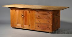 Shaker Pine Work Counter, Mt. Lebanon, New York, c. 1810-30, with a pair of hinged doors and four graduated drawer, old refinish, 30.5 H. x 74 L. x 29.25 D.