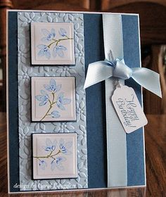 "PTI Enchanted Evening and SU! Bashful Blue card stock, embossing with the SU! Petals A Plenty ef, and using the SU! Carte Postale stamp et. I used Nestabilities squares for the images, and just added 1/8"" to the size and hand-cut the mats. The tag was done with a Cricut, and the sentiment is by SNSS, and ribbon is also Bashful Blue from SU!"