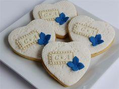 Bespoke ivory wedding cookies with monogram, pearls