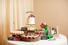 Adorable rustic cake and cupcake display with cake banner.  Photographer: Jeremy & Kristin  Venue: The Orchard Event Venue www.theorchardtx.com. Hidden in a quiet corner of the Fort Worth metroplex is The Orchard, a new, state of the art venue that will serve as the perfect backdrop for all of life's special occasions. Outdoor Wedding Venue   Fort Worth Wedding Venue   Rustic Wedding Venue   Country Wedding Venue   Elegant Wedding Venue