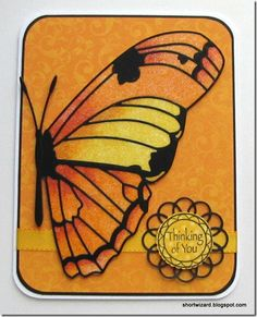 handmade card ... half a butterfly fills the page ... deep oranges and yellow with black accents ... luv the subtle background paper  ... marker coloring on glitter ... die cut loopy border circle for sentiment base ... beautiful card!